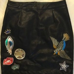 Faux Leather skirt with decorative patches